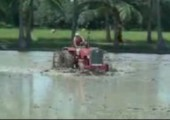 Ein Mann und sein Traktor