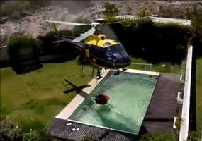Feuerlösch-Hubschrauber klaut sich Wasser aus Pool