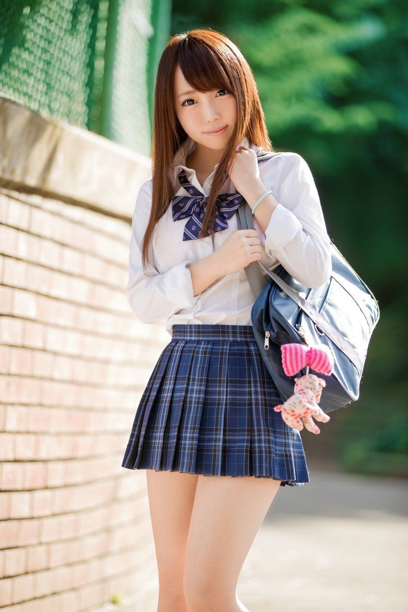 Cute chinese teenager wearing short skirt stock photo