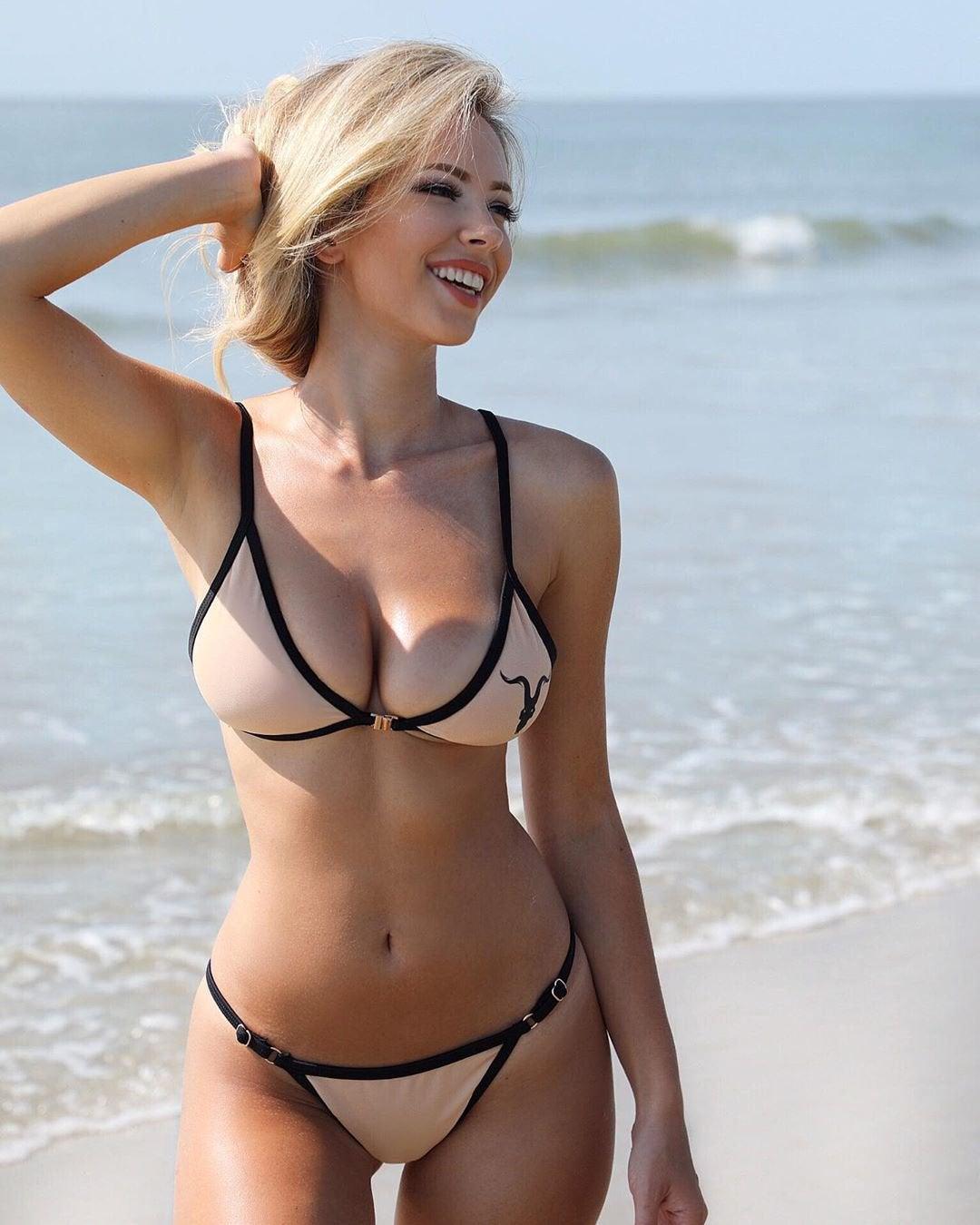 Sexy Girl Wearing Bikini Swimsuit In A Sea Free Stock Photo