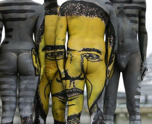 ** EDS NOTE NUDITY ** The portrait of U.S. President Barack Obama is seen as a body painting  during the performance 'The Fusion Journey' of Swiss artist 'Dave' (No Last Name) in Berlin on Thursday, May 21, 2009.  (AP Photo/Markus Schreiber)